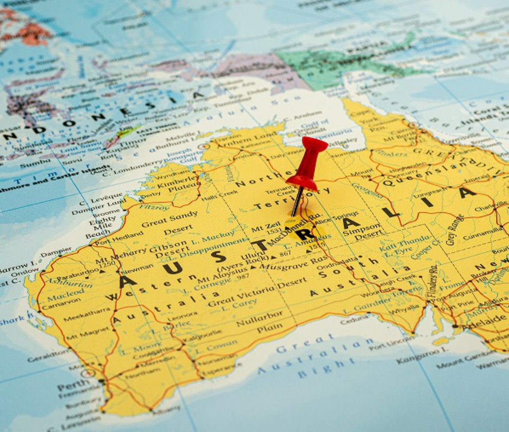 red pin placed selective at Australia map. - economic and government concept.